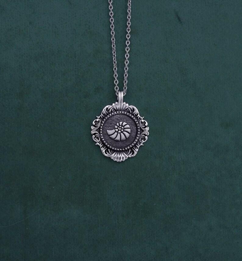 Tiny ammonite necklace vintage marine shell spirit sterling image 0