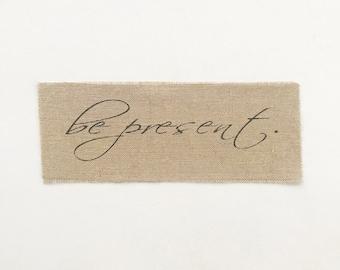 be present unframed burlap print