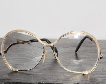 Oversized round Silhouette eyeglasses,gold frames,funky,ornate detailing,spectacles,round rim glasses,stage props,1970s,metal frame,eyewear