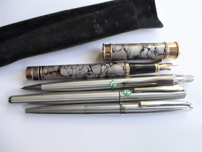 Destash of random metal items  Pens  keys  Morgan car key fob  Silver plated box  Penknife  Dog tags  Pickle fork top  Ref 94