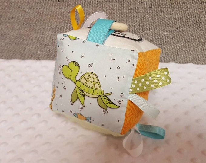 Featured listing image: Atlas & Ellie Exclusive Fabric!  Sea Turtle Activity Cube for Newborn to 1 year old. Perfect for tummy time and teething. Order today!