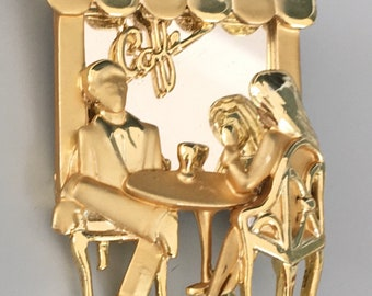 lovely vintage signed AJC couple at sidewalk cafe brooch