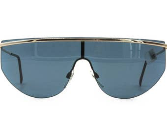 99304acb96 Vintage deadstock mask sunglasses mono lens LUXOTTICA mod. 7077 golden  plated 18K    Hip Hop sunglasses blue lens    NOS