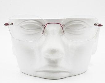 702e046086 Red metallized oval eyeglasses rimless 1990s BIG-APPLE