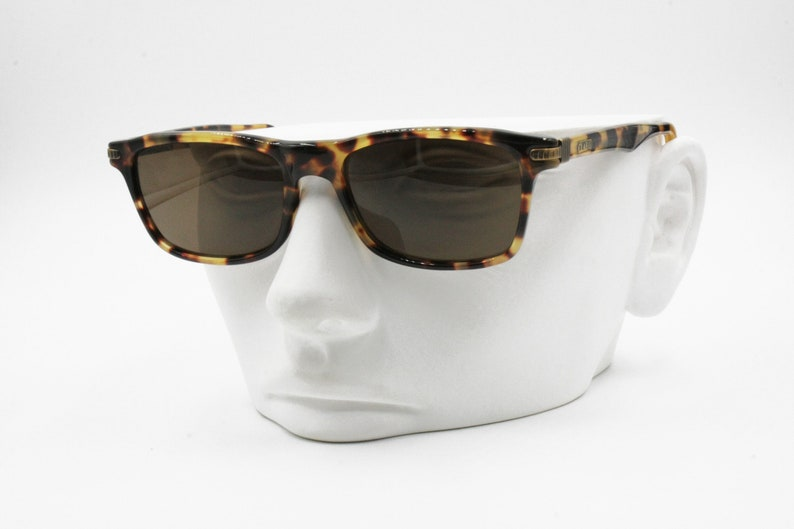 fake tortoise shell acetate /& golden aged end pieces New Old Stock 90s Clark by Trevi Vintage sunglasses 90s