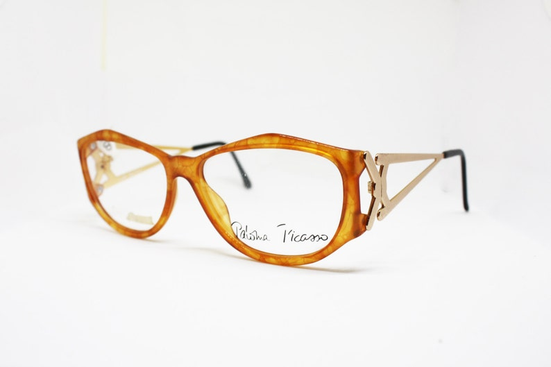 58c8e77586 Paloma Picasso Eyeglasses 3726 11 scaled reptilians orange