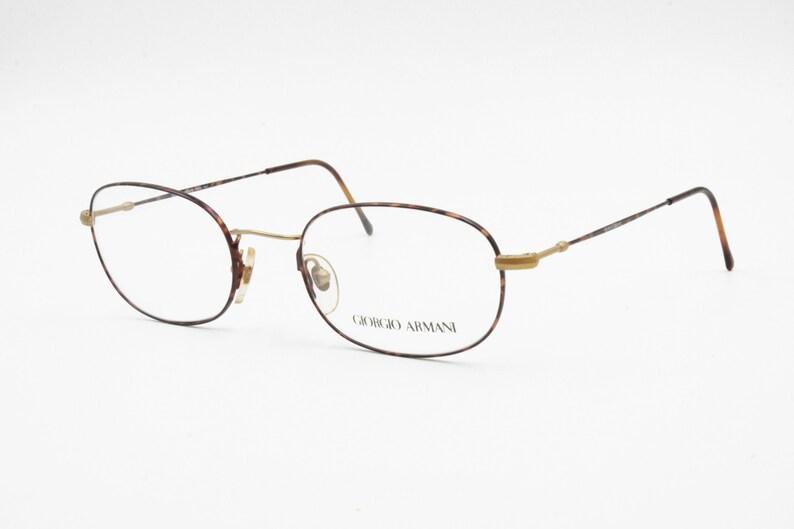 858fd8a36 Giorgio Armani Vintage eyeglasses frame slim metal animalier | Etsy
