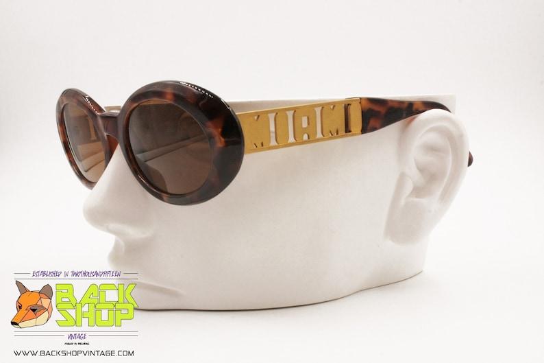 ce17eac407 GIANNI VERSACE mod. 527/M col. 869 OD Vintage 90s sunglasses | Etsy