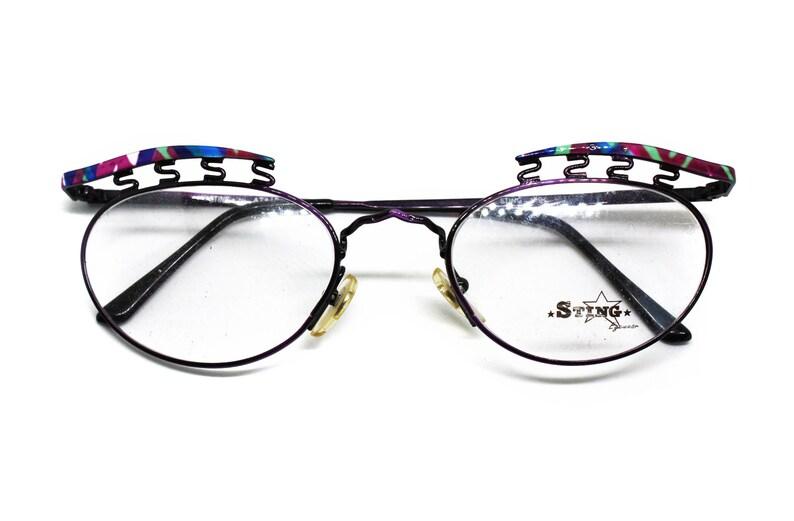 059dd6375f7676 Gek en ongewoon STING door ATAIR brillen     zonnebril