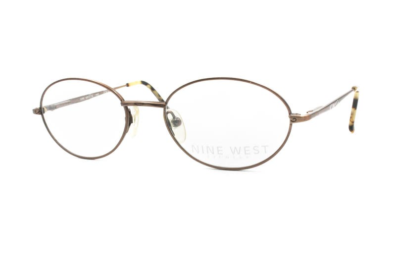 e19f04aea84 NINE WEST mod. 7ws oval frame eyewear Fleet Arm System