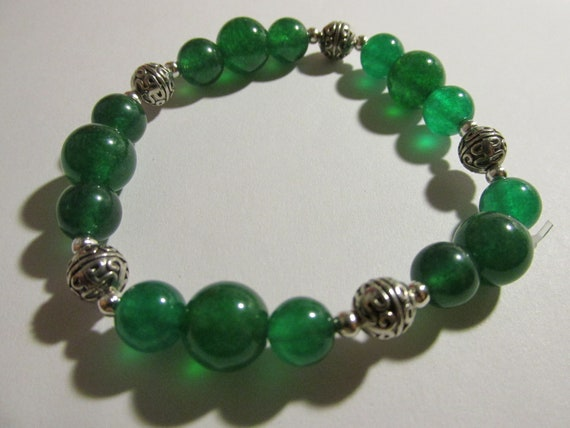 Stretchy Green Beaded Bracelet with Spacers and a Pair of Earrings