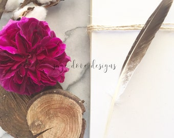 Download Free Marble Styled Stock Flatlay Photography With Magenta Rose, Feather and Eucalyptus PSD Template