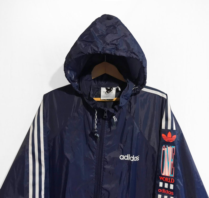 ab37c35e8b105 Vintage 90s Adidas Trefoil Windbreaker One World Packable jacket Navy  Blue/White/Orange/Green Size L