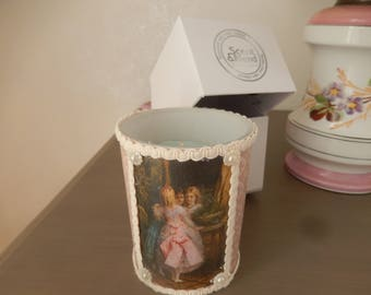 scented candle dressed tissue box and old painting on fabric