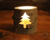 Pine tree cut-out candle ...