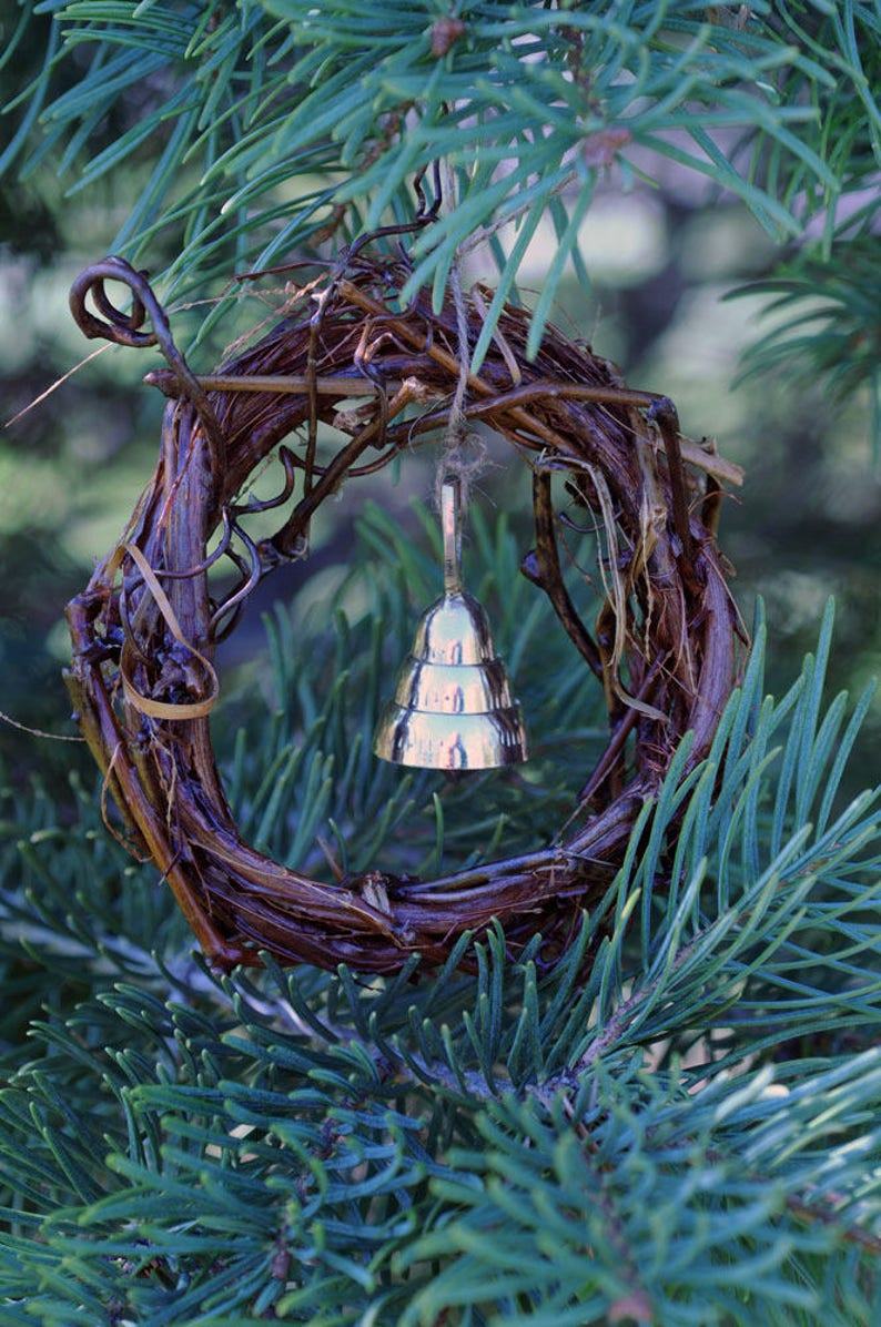 Christmas ornaments made from wild grape vines  brass bells  image 0