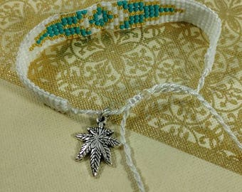 White, Gold and Turquoise Beaded Cannabis Leaf Bracelet.