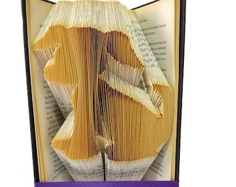 Puppy dog book folding pattern. DIY dog lover gift. Puppy dog book.  Create your own book sculpture. Free tutorial