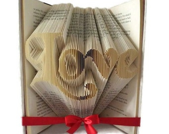 Love book folding pattern. Make a wedding or engagement gift, or unique home decor. Love word art /  book sculpture. Free tutorial