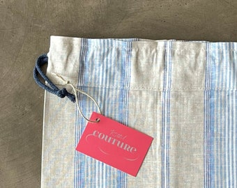 Premium bread bag made of beige linen with blue, white stripes