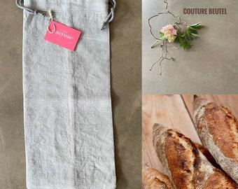 Baguette bag made of grey linen fabric in vintage look