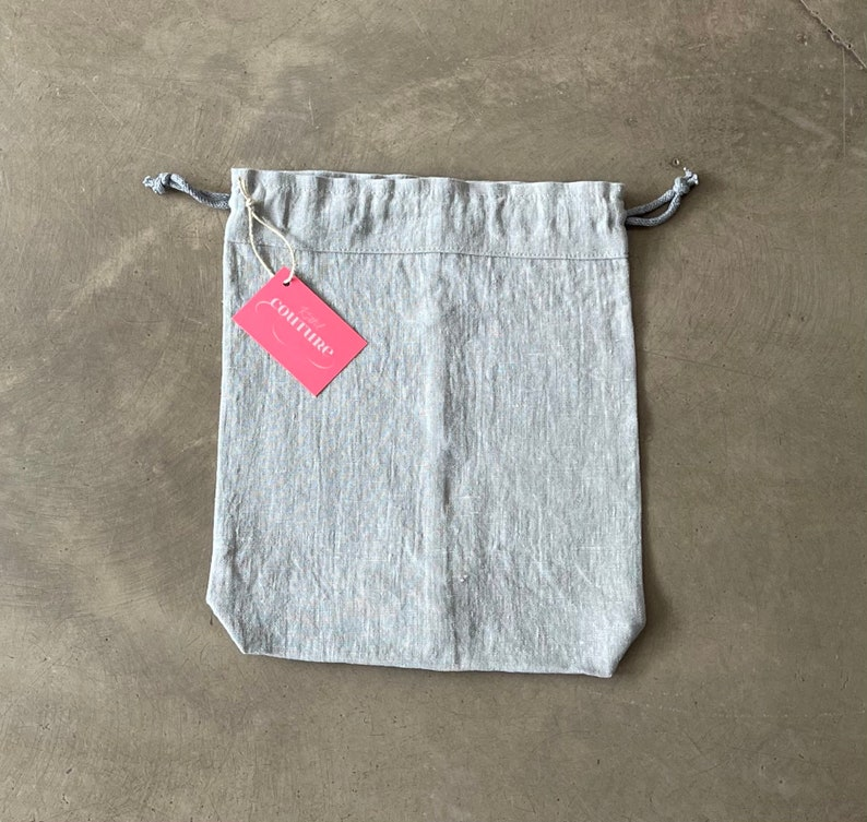 Bread bag made of light grey linen fabric in vintage look image 0