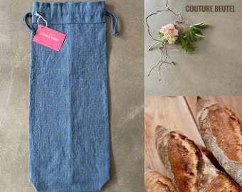 Baguette bag made of petrol-coloured linen fabric in vintage look