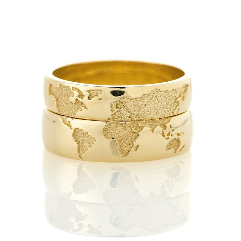14k Gold wedding bands set with world map. Travelers wedding image 0