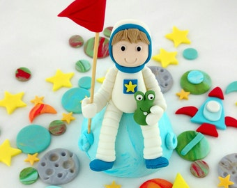 Astronaut and Alien Cake Birthday Cake Topper, with stars, meteors, planets, rocket and ufo decorations.