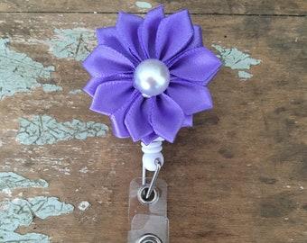 Pearl centered satin pinwheel flower ID badge reel holder retractable clip