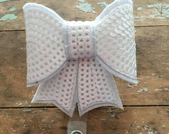 White sequin bow ID badge reel holder retractable clip