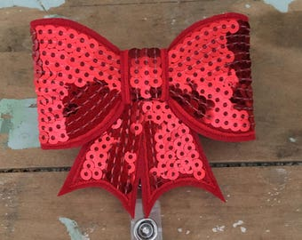 Red sequin bow ID badge reel holder retractable clip