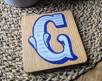 Hand-painted letter 'G' oak coaster