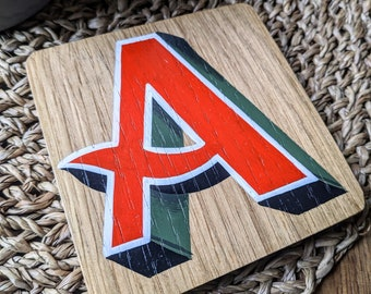 Hand-painted letter 'A' oak coaster