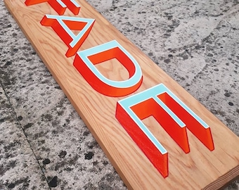 Hand-painted wooden FADE sign