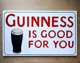 Hand-painted wooden Guinness sign