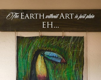 The Earth without Art is just plain EH... wood sign/picture hanger