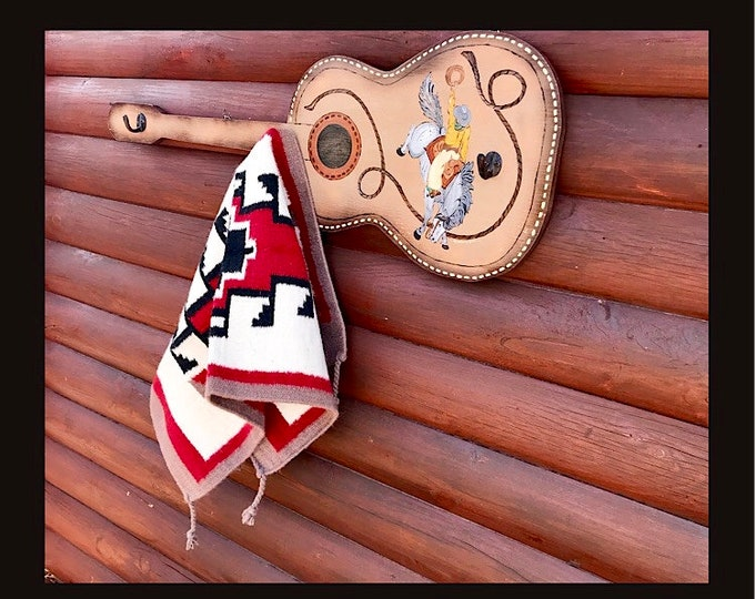 Western decor, cowboy decor, wild west bucking bronc on western retro faux wood guitar, coat hooks, hat hanger, bridle display, entry hall