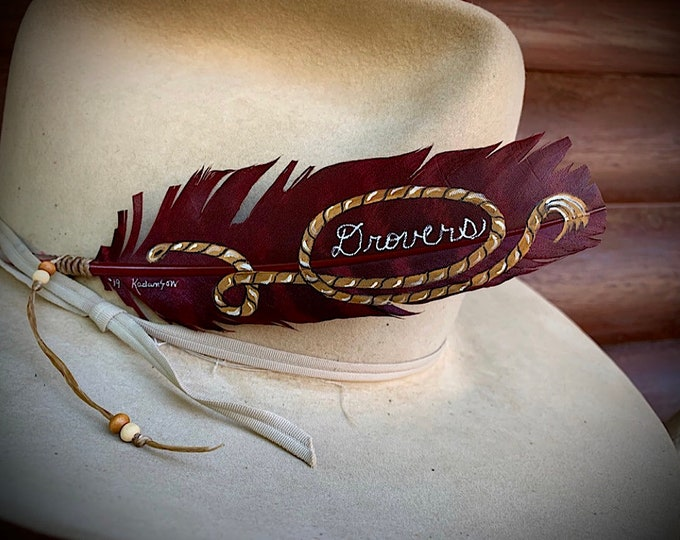 Cowboy hat feather, hand painted maroon turkey wing feather, western lariat rope accent and lettering, sinew beaded wind tie, western retro