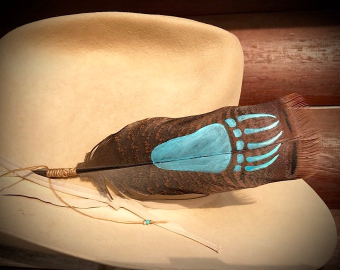 Bear paw hand painted on a unique Bronze colored pre tail wild turkey feather, with beaded wind tie, western retro fashion, custom hat art