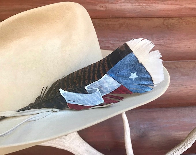 Texas lone star flag hat feather, red, white and metallic blue, on a small size wild turkey tail feather, cowgirl or cowboy hat feather art