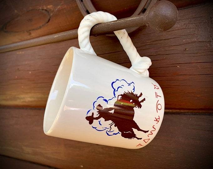 Vintage western coffee cup for that perfect cup of cowboy or cowgirl coffee, bucking bronc and brands, with lariat rope handle, collectible