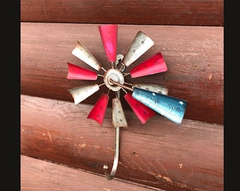 Windmill hook, coat hanger, cap hook, rustic metal spinning windmill, red, blue flag, bridle hook vintage  Aeromotor windmill, one of a kind