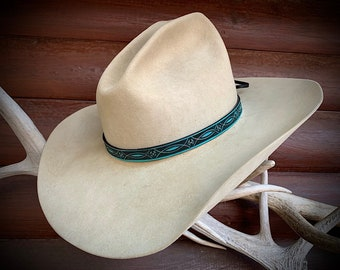 Leather hat band, 5/8 inch wide, stamped leather pattern in turquoise and antiqued black finish, adjustable leather ties, one size fits all