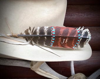 The original custom hat feather, personalized with your initials, tribal turquoise, copper pattern, sinew wind tie, wild turkey wing feather