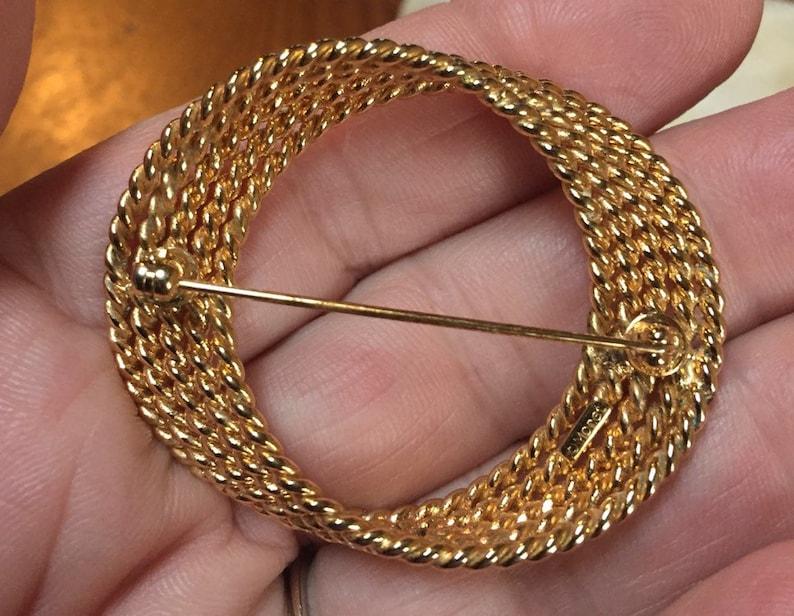 Monet Gold Tone Circular Braided Brooch