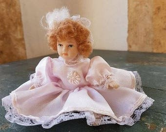 Vintage small doll