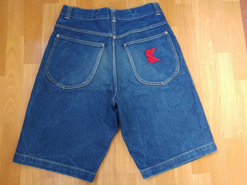 4f05763f18f21 KARL KANI cortos hip-hop pantalones vaqueros del dril de
