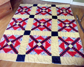 Handmade quilt ,  100 percent cotton, hand quilted quilted , Hand sewn together, 68x60, feed sack