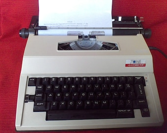 Vintage electric typewriter with new corrector ribbon,Working typewriter, electric typewriter, Towa made in Japan,with instruction book
